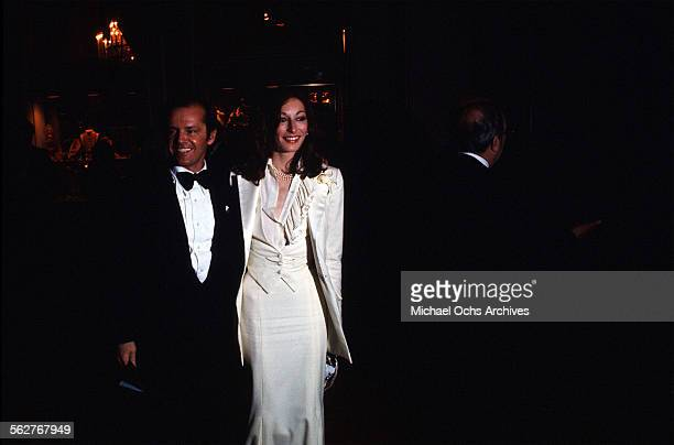 Actor Jack Nicholson and actress Anjelica Huston arrive to the 48th Academy Awards at Dorothy Chandler Pavilion in Los AngelesCalifornia
