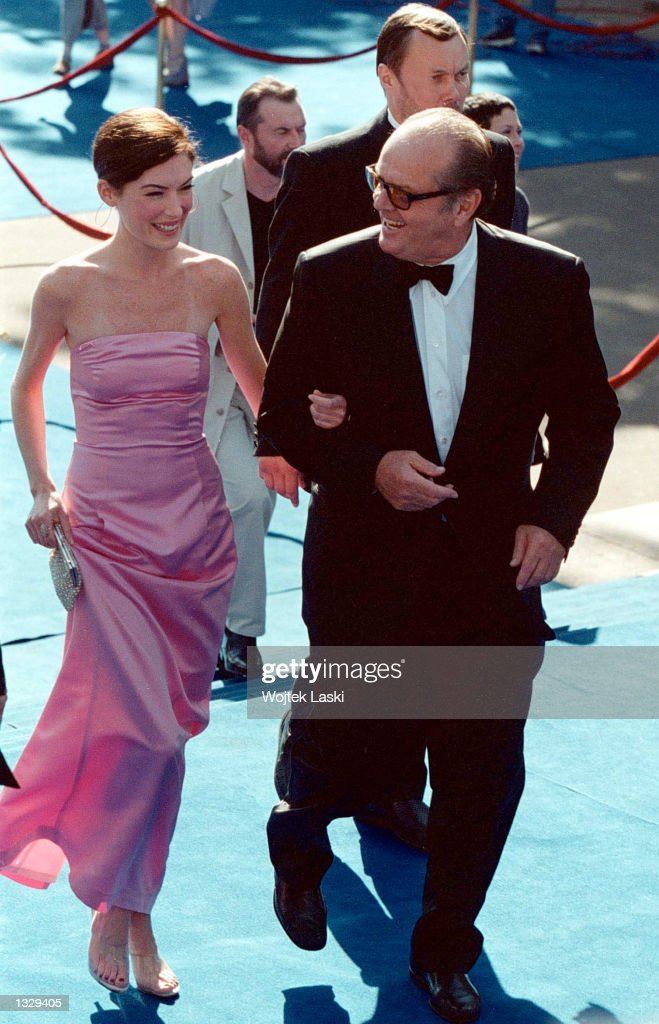 Actor Jack Nicholson and his girlfriend actress Lara Flynn Boyle arrive at the Moscow International Film Festival June 30 2001 in Moscow