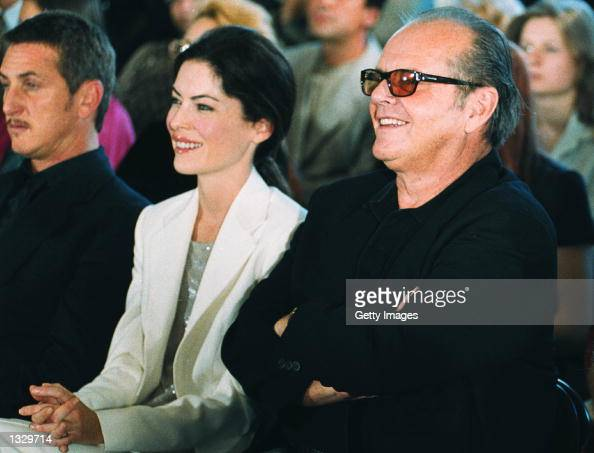 Actor Jack Nicholson and his girlfriend Lara Flynn Boyle attend a fashion show during the Moscow International Film Festival June 27 2001 in Russia