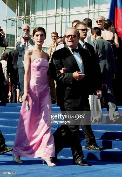 Actor Jack Nicholson and his girlfriend Lara Flynn Boyle walk to a closing ceremony of the Moscow International Film Festival June 30 2001 in Moscow...