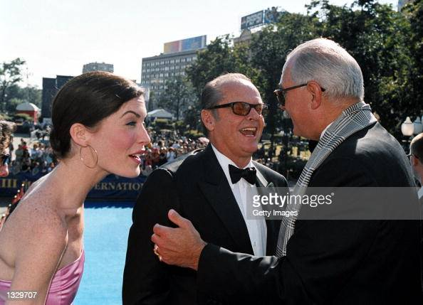 Actor Jack Nicholson center and his girlfriend Lara Flynn Boyle talk with Russian director Nikita Mikhalkov June 30 2001 as they head to a closing...