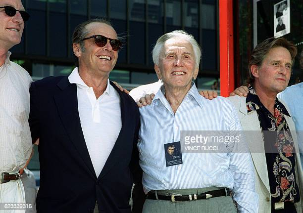 US actor Jack Nicholson greets veteran actor Kirk Douglas and his son actor Michael Douglas after a ceremony honoring Michael who placed his hands...