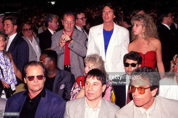Actor Jack Nicholson Singer Paul Simon with Actor Warren Beatty and Comedian David Brenner next to unknown female in red dress at Tyson vs Holmes...