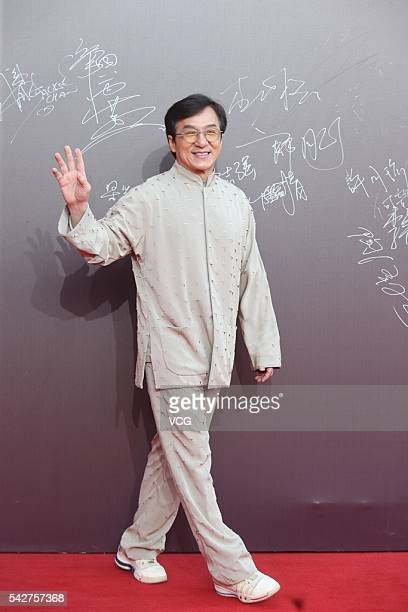 Actor Jackie Chan arrives at the red carpet of the 16th China Huabiao Film Awards on June 24 2016 in Beijing China
