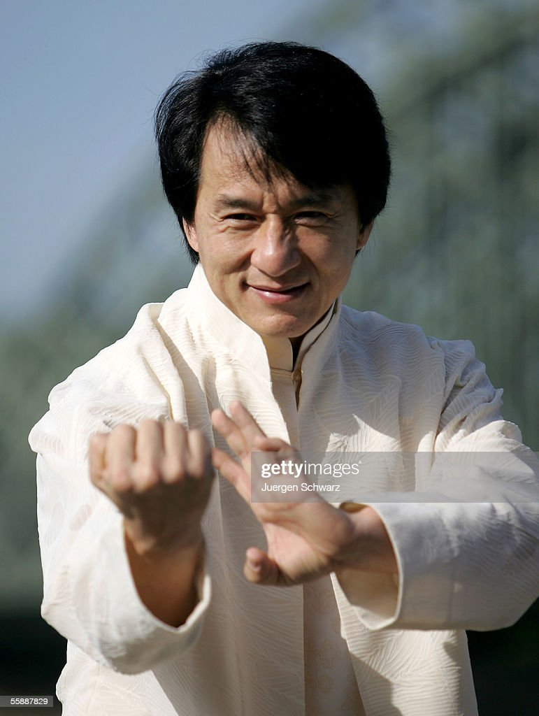 Actor Jackie Chan poses in front of a river Rhine bridge prior to tonight's premiere of his new film, 'New Police Story' on October 10, 2005 in Cologne, Germany.
