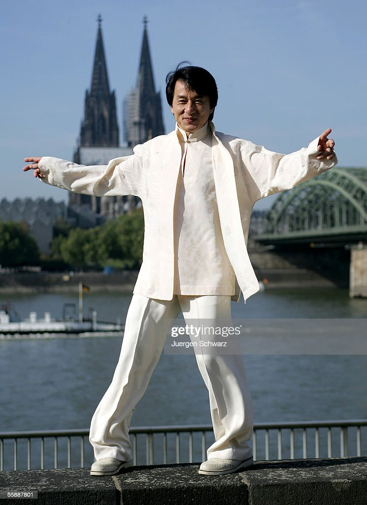 Actor Jackie Chan poses in front of Cologne Cathedral prior to tonight's premiere of his new film, 'New Police Story' on October 10, 2005 in Cologne, Germany.