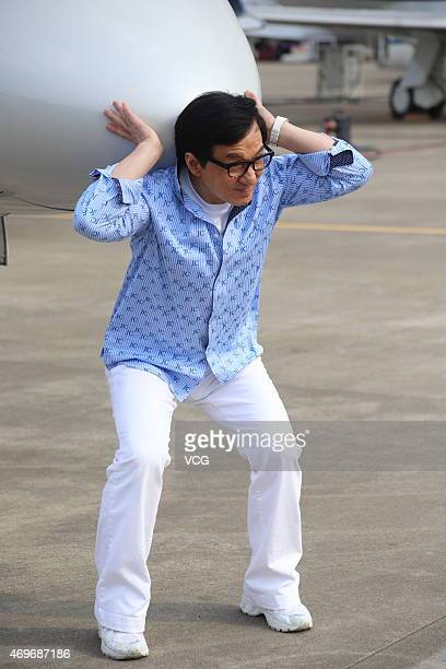 Actor Jackie Chan shows at the 2015 Asian Business Aviation Conference Exhibition the day before its open on April 13 2015 in Shanghai China The...