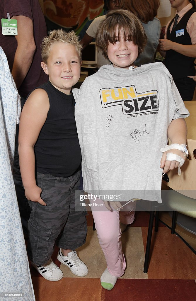 Actor Jackson Nicoll poses with a patient at 'Fun Size' Special Screening At Children's Hospital Los Angeles at Childrens Hospital Of Los Angeles on...