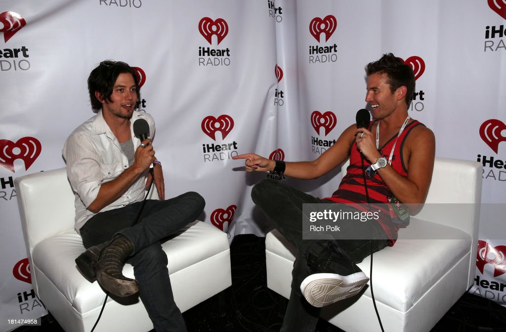 Actor Jackson Rathbone (L) and Nathan Fast backstage during the iHeartRadio Music Festival Village on September 21, 2013 in Las Vegas, Nevada.