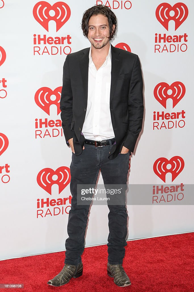 Actor Jackson Rathbone poses in the iHeartRadio music festival photo room on September 20, 2013 in Las Vegas, Nevada.