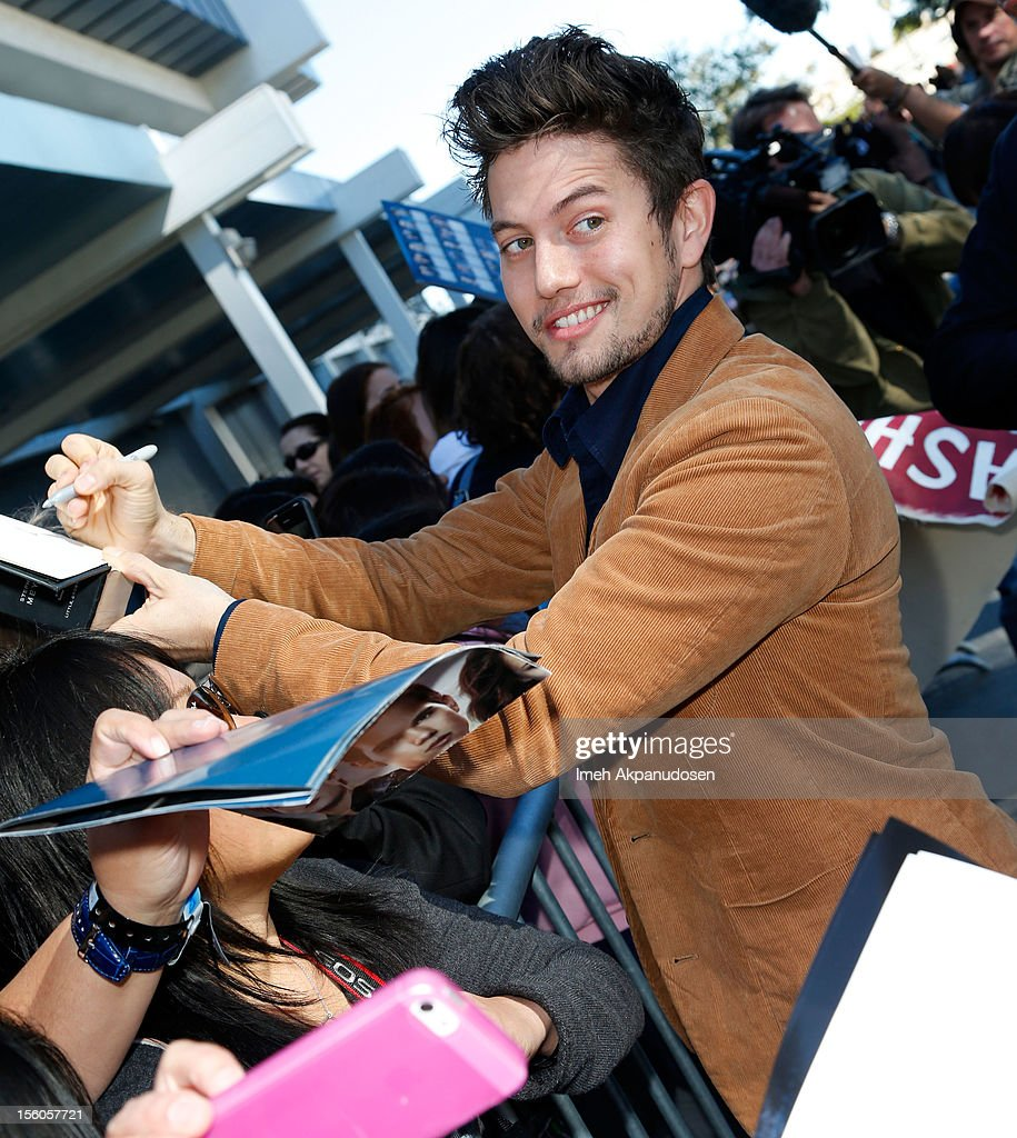 Actor <a gi-track='captionPersonalityLinkClicked' href=/galleries/search?phrase=Jackson+Rathbone&family=editorial&specificpeople=4070053 ng-click='$event.stopPropagation()'>Jackson Rathbone</a> signs autographs for fans at the 'Twilight Saga: Breaking Dawn Part 2' Fan Camp held at L.A. LIVE on November 11, 2012 in Los Angeles, California.