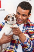 Actor Jacob Artist and actor dog Uggie attend Abercrombie Fitch's 'Stars on the Rise' event at Abercrombie Fitch on July 11 2013 in Los Angeles...