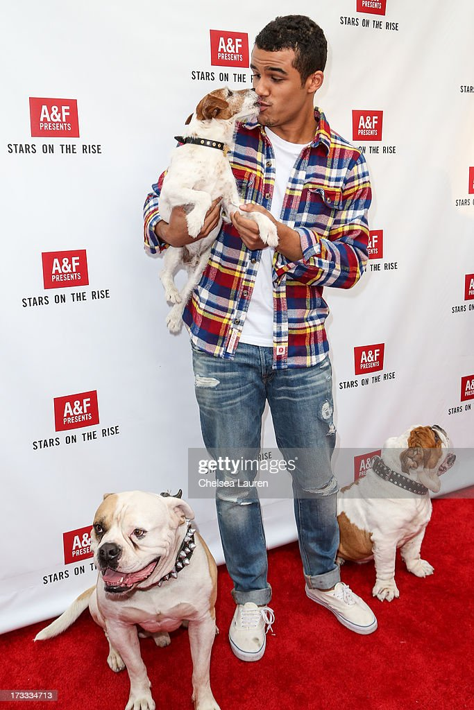 Actor Jacob Artist with actor dogs (L-R) Popeye, Uggie, and Julio attend Abercrombie & Fitch's 'Stars on the Rise' event at Abercrombie & Fitch on July 11, 2013 in Los Angeles, California.