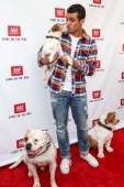 Actor Jacob Artist with actor dogs Popeye Uggie and Julio attend Abercrombie Fitch's 'Stars on the Rise' event at Abercrombie Fitch on July 11 2013...