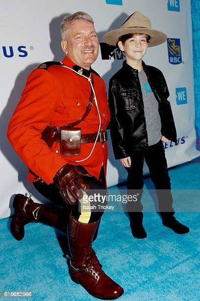 Actor Jacob Tremblay is greeted by a Royal Canadian Mounted Police constable during We Day Toronto at Air Canada Centre on October 19 2016 in Toronto...