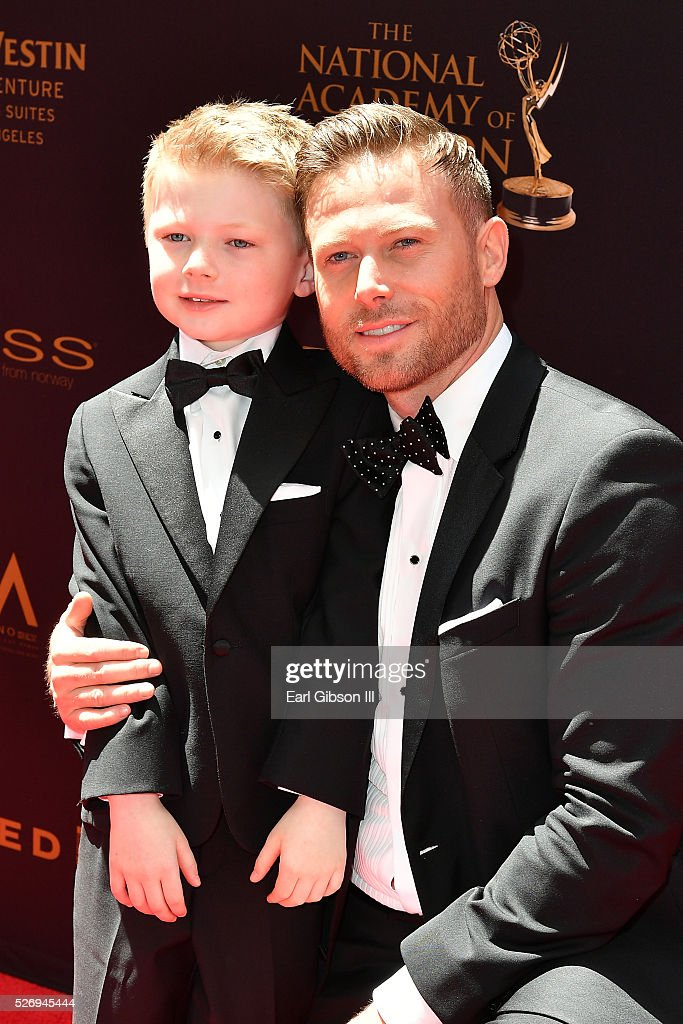 Actor Jacob Young (R) walks the red carpet at the 43rd Annual Daytime Emmy Awards at the Westin Bonaventure Hotel on May 1, 2016 in Los Angeles, California.