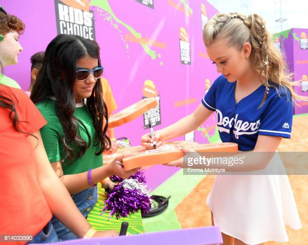 Actor Jade Pettyjohn signs an autograph for a fan at Nickelodeon Kids' Choice Sports Awards 2017 at Pauley Pavilion on July 13 2017 in Los Angeles...