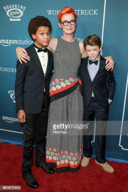 Actor Jaden Michael costume designer/executive producer Sandy Powell and actor Oakes Fegley attend the premiere of Roadside Attractions'...