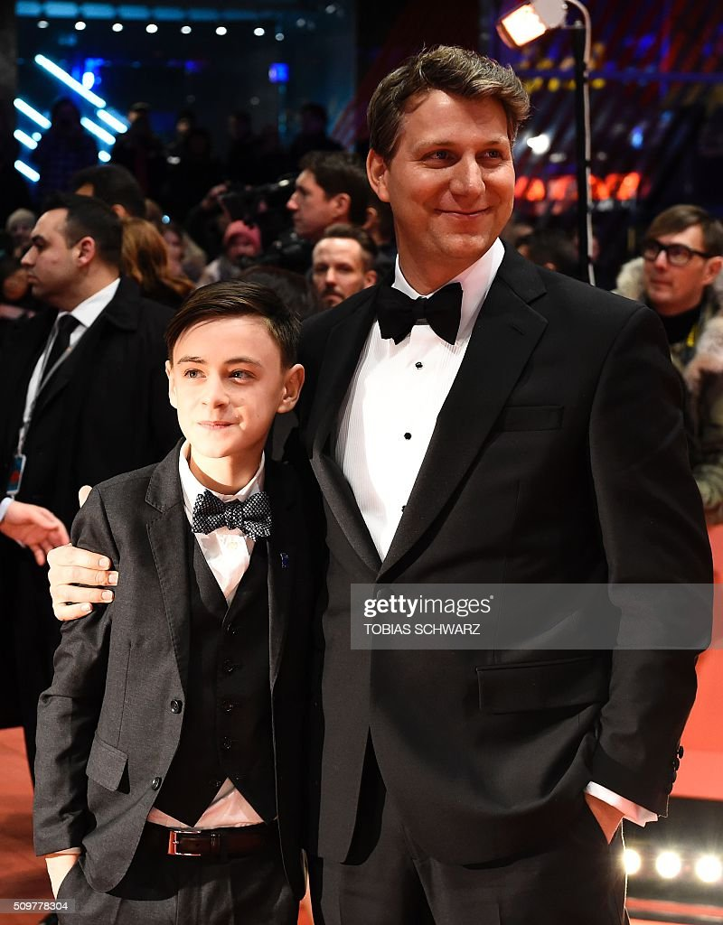US actor Jaeden Lieberher and US director Jeff Nichols pose for photographers as she arrives for the screening of the film ' Midnight Special by Jeff Nichols' in competition of the 66th Berlinale Film Festival in Berlin on February 12, 2016. / AFP / TOBIAS SCHWARZ