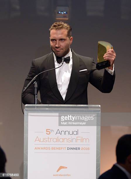 Actor Jai Courtney accepts the FOXTEL Breakthrough Award onstage during Australians In Film's 5th Annual Awards Gala at NeueHouse Hollywood on...