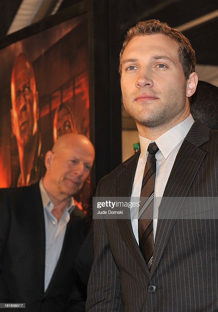 Actor <a gi-track='captionPersonalityLinkClicked' href=/galleries/search?phrase=Jai+Courtney&family=editorial&specificpeople=6723038 ng-click='$event.stopPropagation()'>Jai Courtney</a> (right) and <a gi-track='captionPersonalityLinkClicked' href=/galleries/search?phrase=Bruce+Willis&family=editorial&specificpeople=202185 ng-click='$event.stopPropagation()'>Bruce Willis</a> (in background) attended 'A Good Day To Die' New York Fan Event at AMC Empire on February 13, 2013 in New York City.