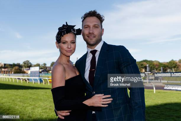 Actor Jai Courtney and Mecki Dent celebrate ont he track after Winx's victory at Royal Randwick Racecourse on April 8 2017 in Sydney Australia