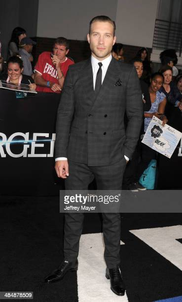 Actor Jai Courtney arrives at the Los Angeles premiere of 'Divergent' at Regency Bruin Theatre on March 18 2014 in Los Angeles California