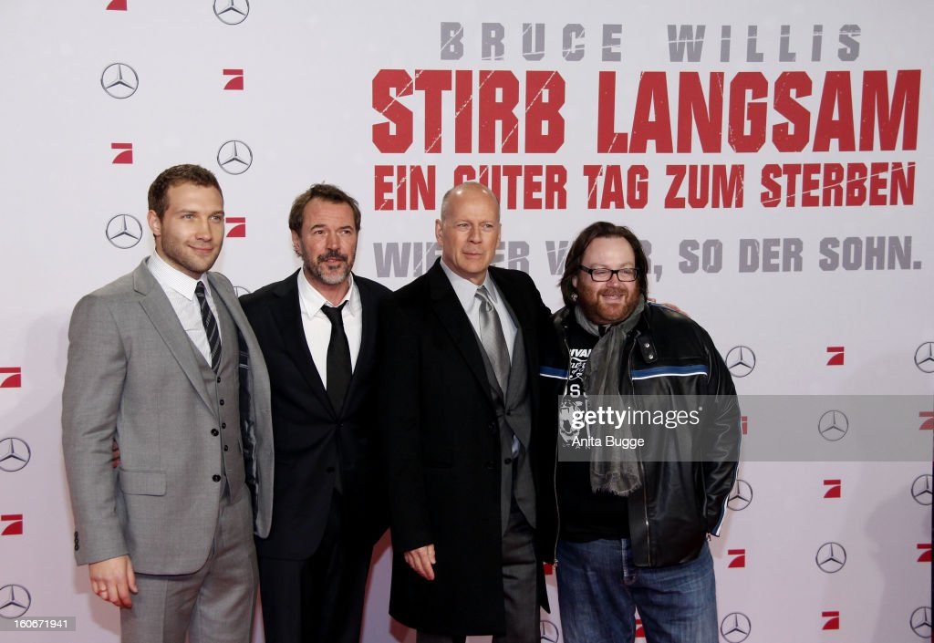 Actor Jai Courtney, German actor <a gi-track='captionPersonalityLinkClicked' href=/galleries/search?phrase=Sebastian+Koch&family=editorial&specificpeople=636122 ng-click='$event.stopPropagation()'>Sebastian Koch</a>, actor Bruce willis and director John Moore attend the 'Die Hard - Ein Guter Tag Zum Sterben' Germany premiere at CineStar Sony Center on February 4, 2013 in Berlin, Germany.