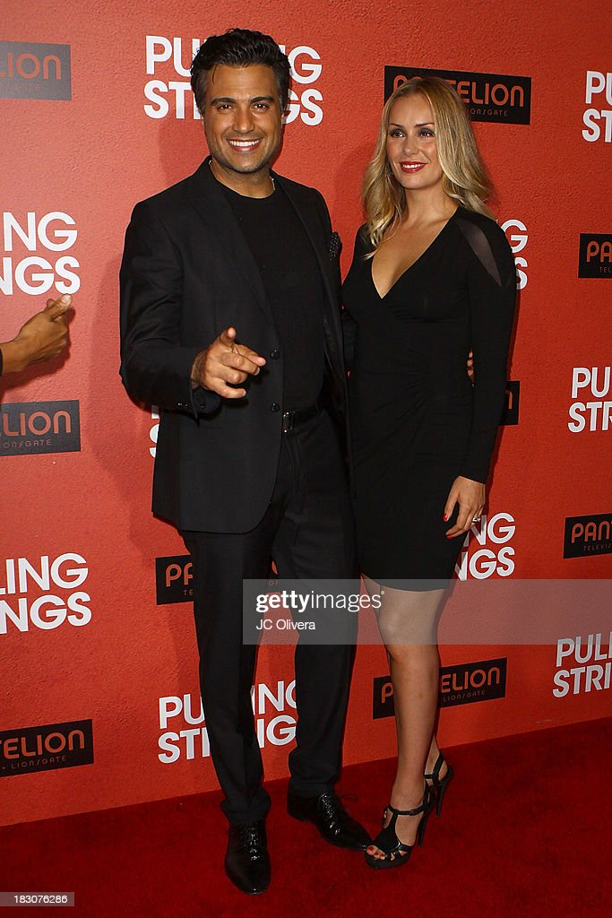 Actor <a gi-track='captionPersonalityLinkClicked' href=/galleries/search?phrase=Jaime+Camil&family=editorial&specificpeople=580441 ng-click='$event.stopPropagation()'>Jaime Camil</a> (L) and wife Heidi Balvanera attend the Los Angeles Premiere of 'Pulling Strings' at Regal Cinemas L.A. Live on October 3, 2013 in Los Angeles, California.