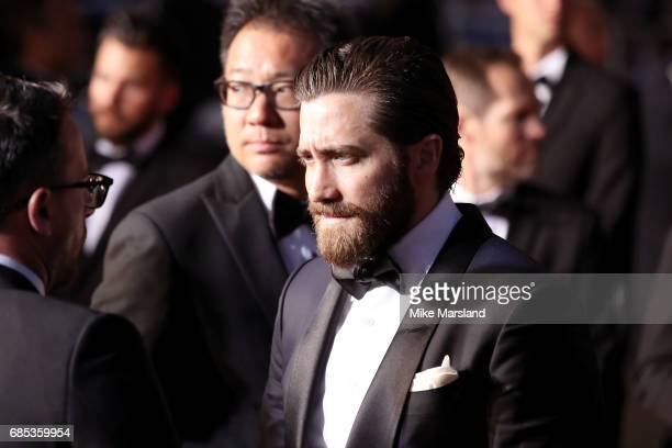 Actor Jake Gyllenhaal departs the 'Okja' screening during the 70th annual Cannes Film Festival at Palais des Festivals on May 19 2017 in Cannes France