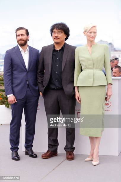 Actor Jake Gyllenhaal Director Bong JoonHo and actress Tilda Swinton attend the 'Okja' photocall during the 70th annual Cannes Film Festival at...