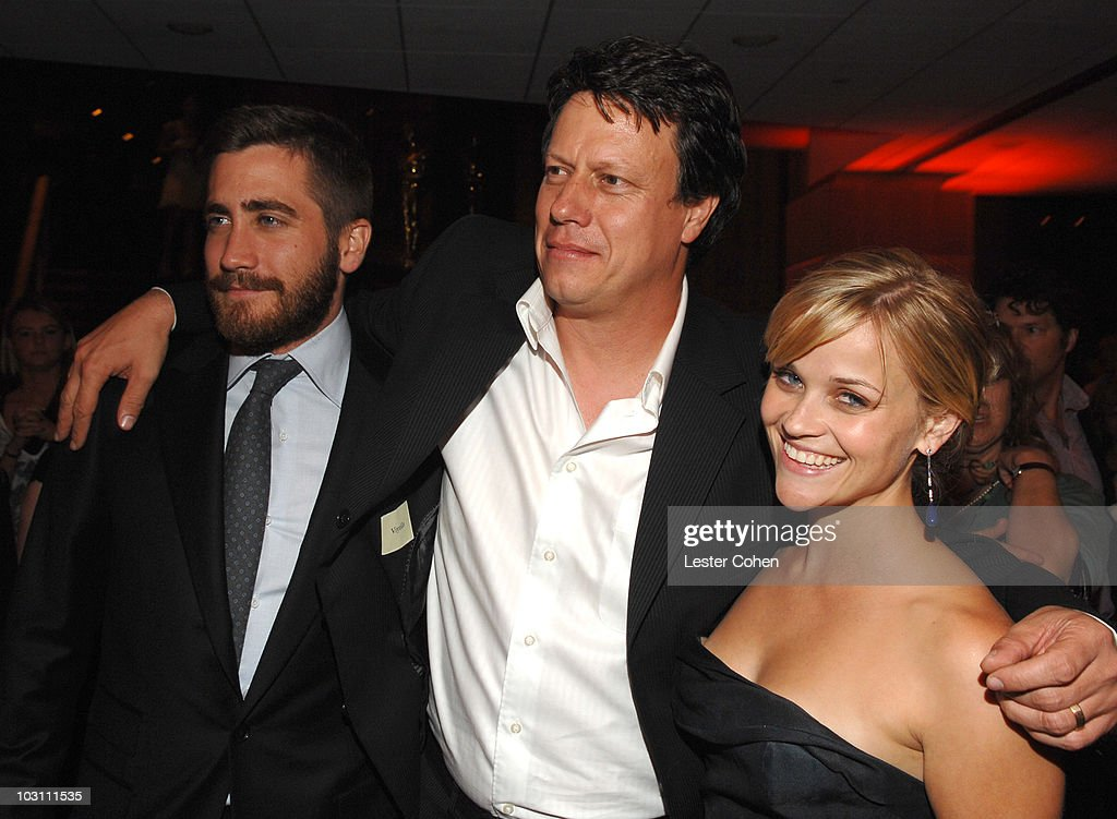 Actor Jake Gyllenhaal director Gavin Hood and actress Reese Witherspoon at the after party for 'Rendition' on October 10 2007 in Los Angeles...