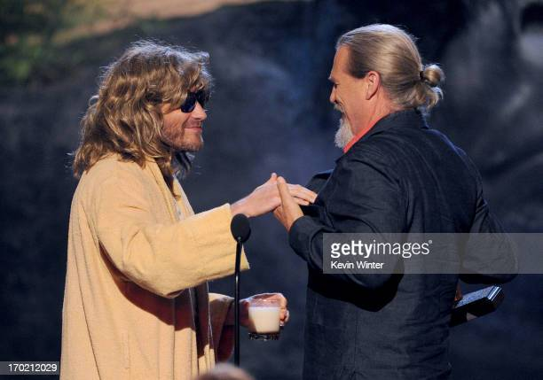 Actor Jake Gyllenhaal presents an award to actor Jeff Bridges onstage during Spike TV's Guys Choice 2013 at Sony Pictures Studios on June 8 2013 in...