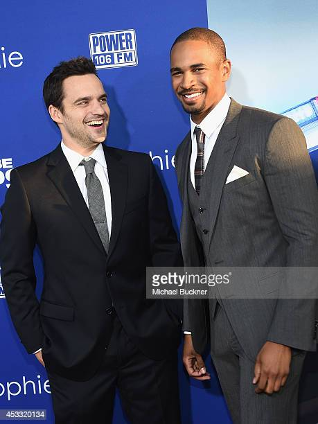 Actor Jake Johnson and actor Damon Wayans Jr arrive at the premiere of Twentieth Century Fox's 'Let's Be Cops' at ArcLight Hollywood on August 7 2014...