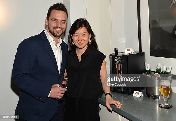 Actor Jake Johnson and Global VP Marketing Stella Artois ABInBev Debora Koyama attend the Stella Artois PerfectDraft Home Bar celebration event on...