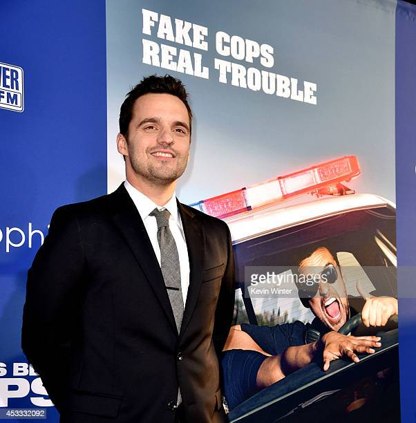 Actor Jake Johnson arrives at the premiere of Twentieth Century Fox's 'Let's Be Cops' at the Cinerama Dome on August 7 2014 in Los Angeles California