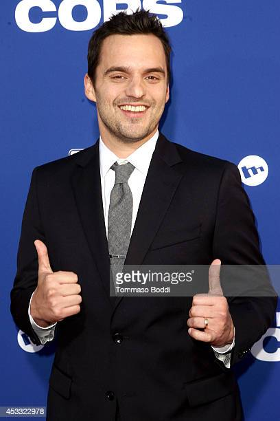 Actor Jake Johnson attends the 'Let's Be Cops' Los Angeles Premiere held at the ArcLight Hollywood on August 7 2014 in Hollywood California