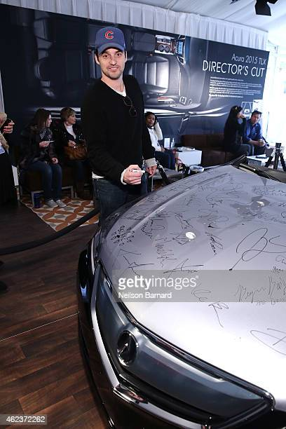 Actor Jake Johnson signs the hood of the all new 2015 Acura TLX at the Acura Studio at the 2015 Sundance Film Festival on January 27 2015 in Park...