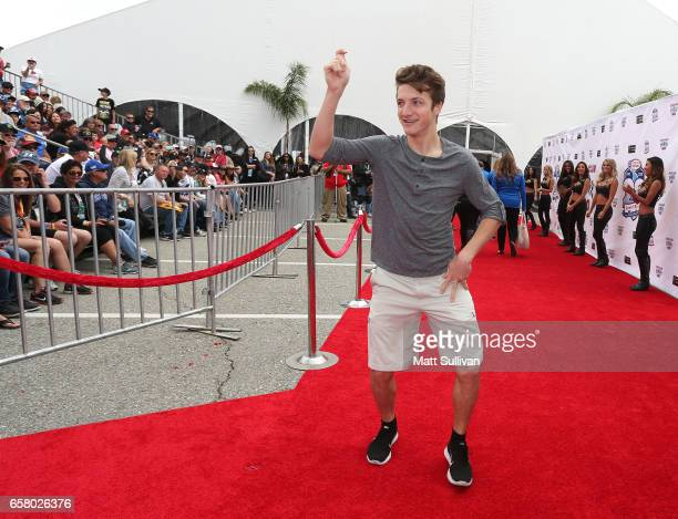 Actor Jake Short walks the red carpet during the drivers meeting for the Monster Energy NASCAR Cup Series Auto Club 400 at Auto Club Speedway on...