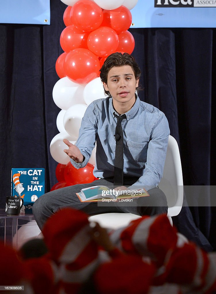 Actor <a gi-track='captionPersonalityLinkClicked' href=/galleries/search?phrase=Jake+T.+Austin&family=editorial&specificpeople=709221 ng-click='$event.stopPropagation()'>Jake T. Austin</a> reads onstage at NEA's Read Across America Day at New York Public Library on March 1, 2013 in New York City.