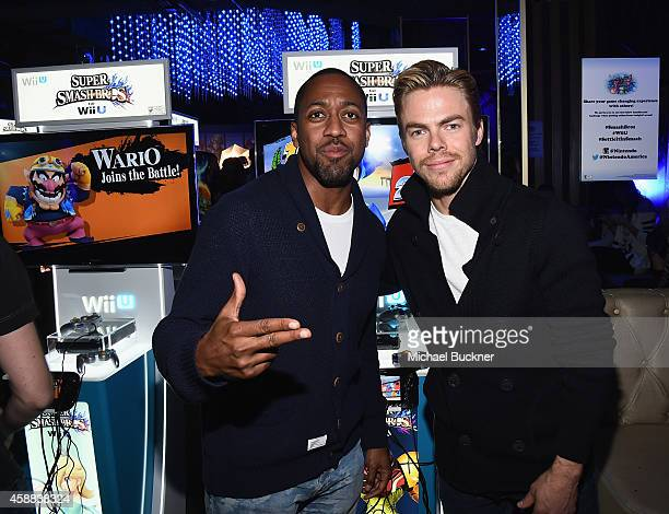 Actor Jaleel White and actor Derek Hough enjoy the festivities during the Super Smash Bros for Wii U event in West Hollywood CA on November 11 2014...