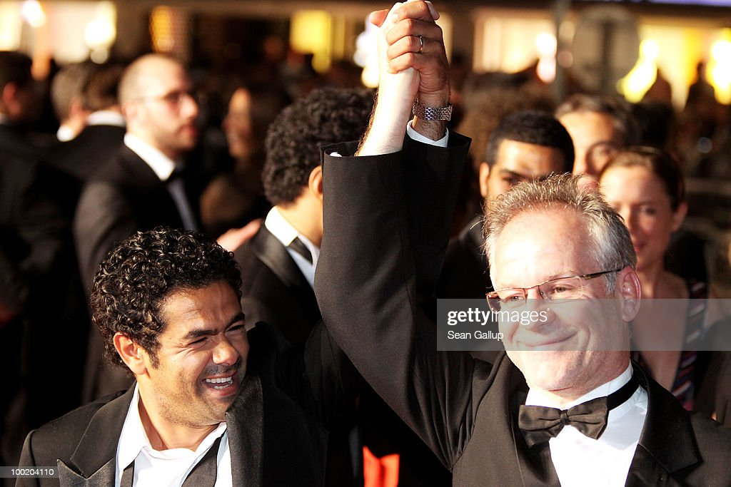 Actor Jamel Debbouze (L) and Director of the Cannes Film Festival Thierry Fremaux depart the 'Outside Of The Law' Premiere at the Palais des Festivals during the 63rd Annual Cannes Film Festival on May 21, 2010 in Cannes, France.