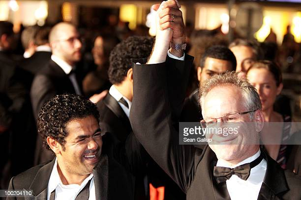 Actor Jamel Debbouze and Director of the Cannes Film Festival Thierry Fremaux depart the 'Outside Of The Law' Premiere at the Palais des Festivals...