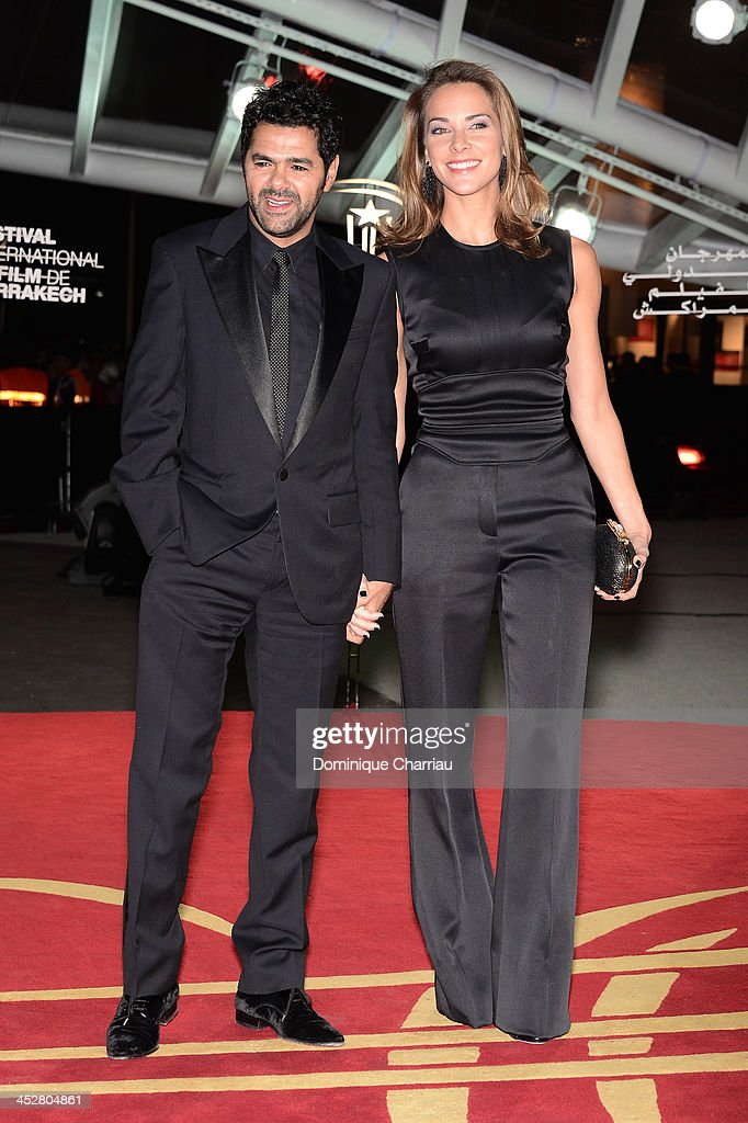 Actor <a gi-track='captionPersonalityLinkClicked' href=/galleries/search?phrase=Jamel+Debbouze&family=editorial&specificpeople=606837 ng-click='$event.stopPropagation()'>Jamel Debbouze</a> and his wife Mélissa Theuriau attend the 'Like Father, Like Son' premiere during the 13th Marrakech International Film Festival on December 1, 2013 in Marrakech, Morocco.