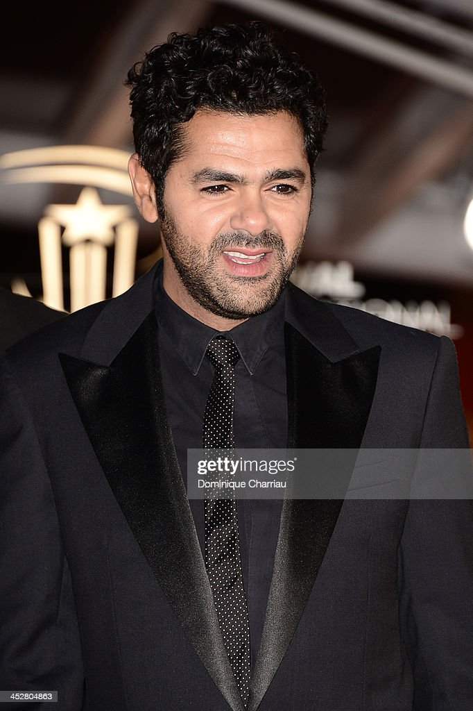 Actor <a gi-track='captionPersonalityLinkClicked' href=/galleries/search?phrase=Jamel+Debbouze&family=editorial&specificpeople=606837 ng-click='$event.stopPropagation()'>Jamel Debbouze</a> attends the 'Like Father, Like Son' premiere during the 13th Marrakech International Film Festival on December 1, 2013 in Marrakech, Morocco.