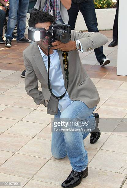Actor Jamel Debbouze takes a photo as he attends the 'Outside the Law' Photo Call held at the Palais des Festivals during the 63rd Annual...