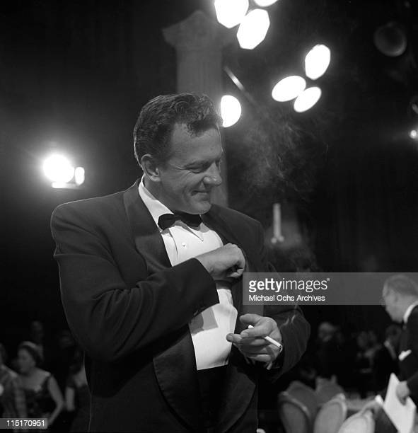 Actor James Arness of TV's 'Gunsmoke' lights one up at the 9th Primetime Emmy Awards held at NBC's Burbank Studios on March 16 1957 in Los Angeles...