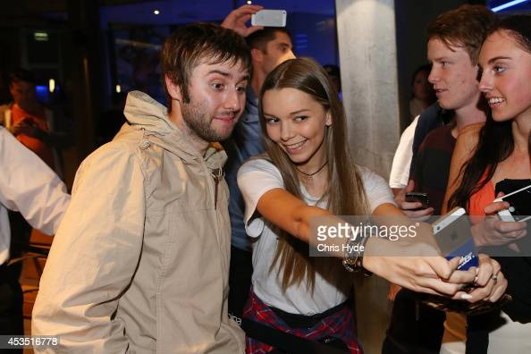 Actor James Buckley poses with a fan at the Queensland Premier of The Inbetweeners 2 at Event Cinemas Robina on August 12 2014 in Gold Coast...