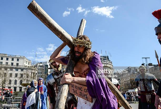 Actor James BurkeDunsmore carries the crucifix whilst playing Jesus during The Wintershall's 'The Passion of Jesus' in front of crowds on Good Friday...