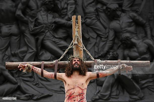 Actor James BurkeDunsmore hangs on the cross as Jesus during the Wintershall's 'The Passion of Jesus' production on Good Friday in Trafalgar Square...